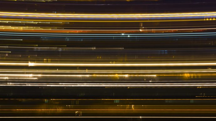 tech-is-rewiring-your-brain-long-exposure-of-cars-going-past-houses