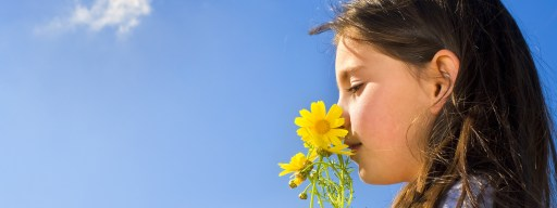 biosensors-girl-sniffing-dandelion