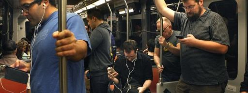 Man uses smartphone jammer on the train.