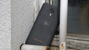 Wileyfox Swift review: The faux stone effect on the rear, and bronze-coloured trim around the camera lens looks pretty good