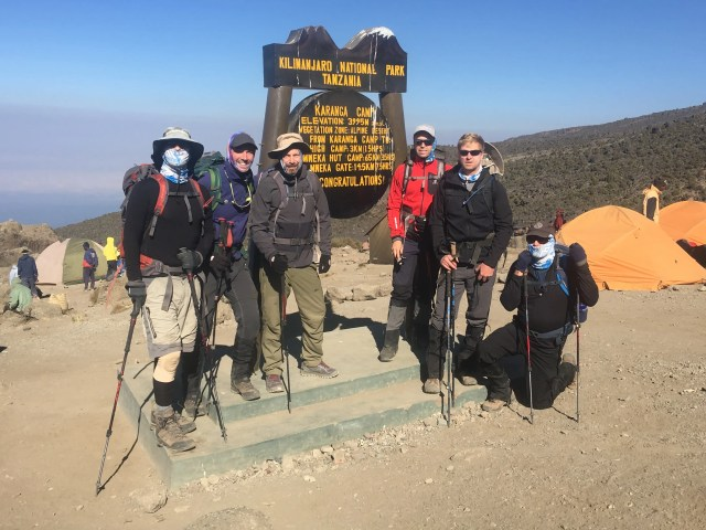 An AAI Kilimanjaro climber group pictured wearing Buffs.