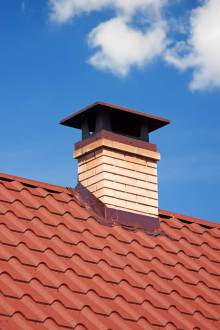 a lovely chimney cap on a red roof
