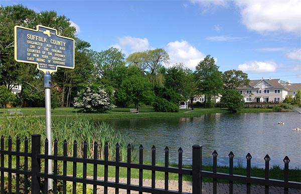 Suffolk CO sign and lake