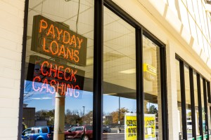 Indianapolis – Circa November 2016: Check Into Cash Consumer Location. Check Into Cash is a payday loan company II