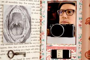 self-portrait of Frank Turek inside one of his book assemblage artworks
