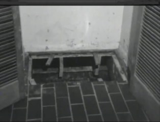 The crawl space that lead to the basement under John Wayne Gacy's home