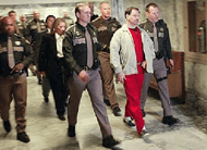 Gary Ridgeway being lead into the courtroom