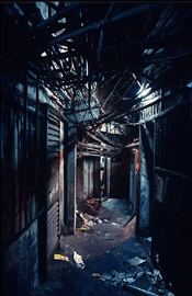Narrow alley covered with wire in Kowloon Walled City