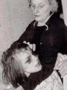 Anneliese Michel, held by her mother