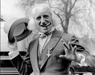Jimmy Savile in front of Buckingham Palace