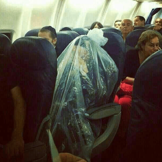 Ultra Orthodox Jewish man wrapped in a life-size plastic bag aboard an airplane