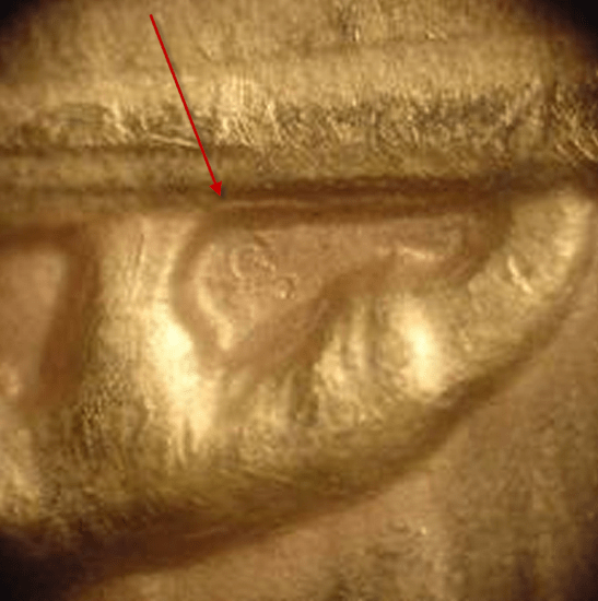 Omega marking on a counterfeit coin