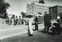 Crowds milling around the assassination scene after the JFK assassination
