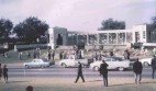 Mourners leave flowers at Dealey Plaza after the assassination