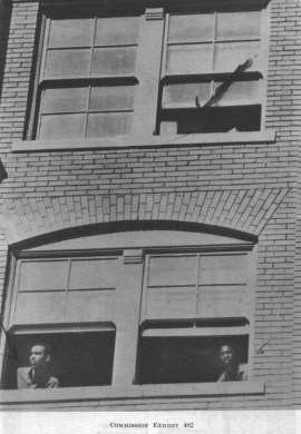Texas School Book Depository just seconds after the shooting. Arrow marks snipers nest.