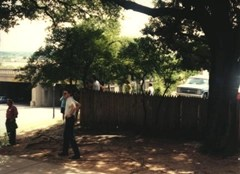 The fence behind the grassy knoll
