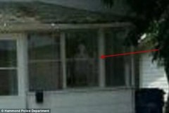Ghostly figure in window of Ammons home