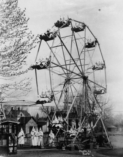 At the time of this photo, sighting Ku Klux Klan in their full garb was not unusual.  Here they are at a carnival in Canon City – 1925.