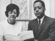 Betty and Barney Hill holding a copy of the book Interrupted Journey