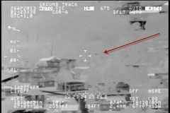 UFO shown flying at low altitude above residential homes
