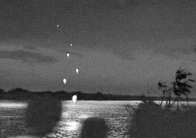 Classic photo of the Naga Fireballs rising from the waters of the Mekong river