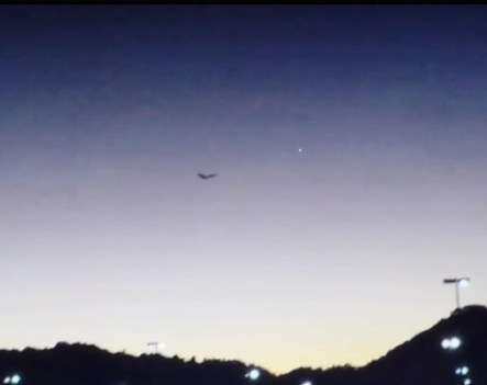 Burst of white light seen in the sky to the right of the butterfly-ufo