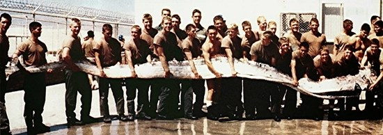 American soldiers holding what appears to be some sort of giant sea creature - circa 1973