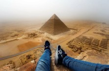 German teen Andrej Cieselski looking down from the Great Pyramid in Egypt