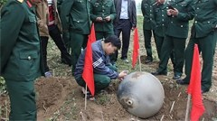 Authorities examining one of the mysterious metal balls that fell from space into Vietnam