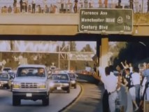 Crowds cheering during the OJ Simpson Bronco chase on LA freeways