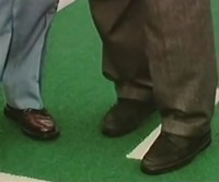 After still more denials, a second photo appears showing OJ Simpson wearing Bruno Magli shoes he claimed to have never owned
