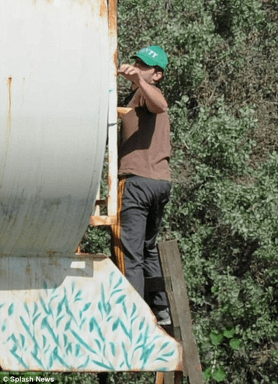 This guy was caught painting a water tank and was suspected to be Banksy