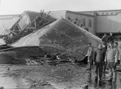 The crumpled molasses tank that burst flooding the streets of Boston