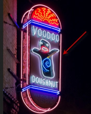 Voodoo Doughnut logo with arrow pointing to area that resembles a pedophile symbol