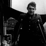 Ernest Hemingway on crutches after being wounded in World War I
