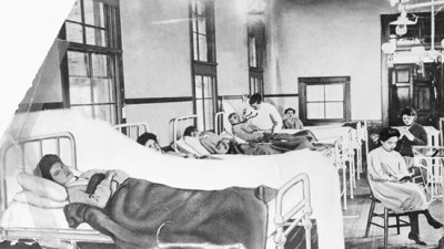 Sick people in old hospital beds