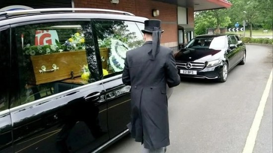 Hearse driver with double-bacon cheeseburger for casket