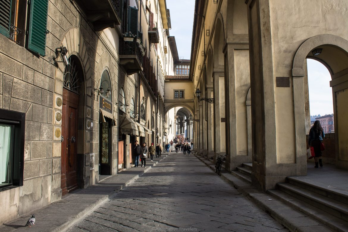 A street by the river in Florence Italy