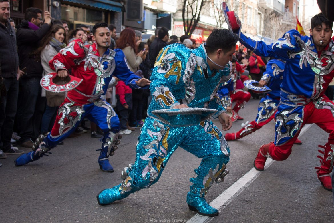 "Men in sparkly ""USA"" costumes in red, white, blue, and gold"