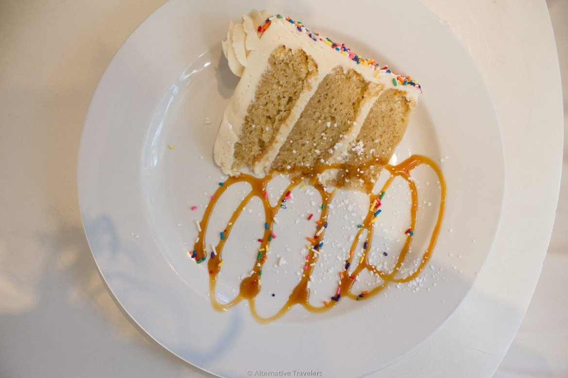 a slice of gluten free vegan cake in Portland at Petunias
