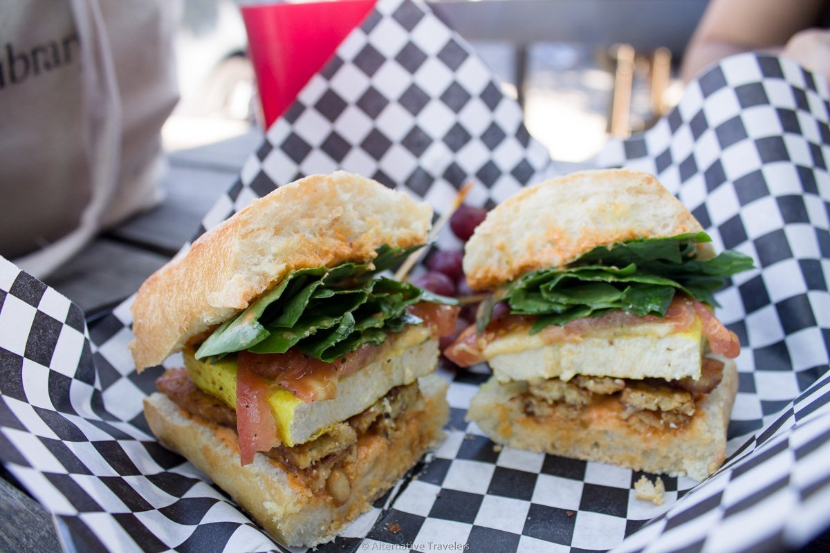 two halves of tempeh bacon and tofu vegan breakfast sandwich at DC Vegetarian in Portland