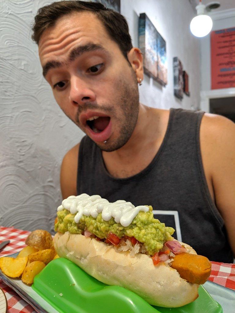 looking at vegan hot dog at Distrito Vegano