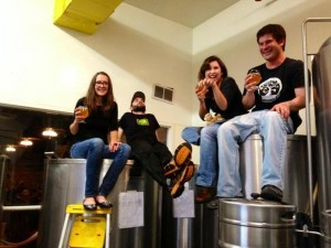 The brewmasters of Altitude Chophouse enjoy one of their pilot beers they just brewed up!