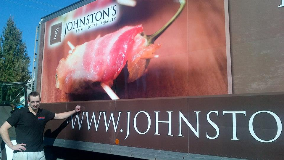 Stephan next to a Johnston's Truck