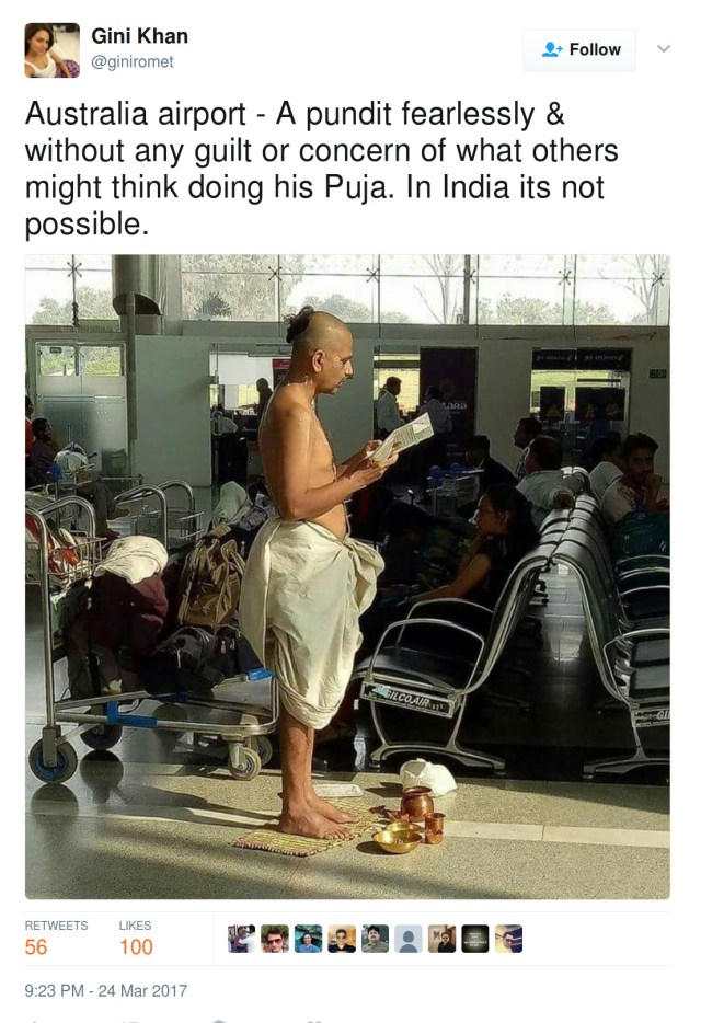 Australia airport - A pundit fearlessly & without any guilt or concern of what others might think doing his Puja. In India its not possible.