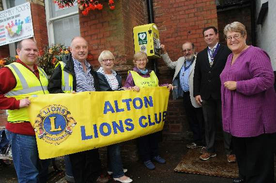Launching the new defibrillator at the Assembly Rooms, from left, are Lions Bill Tigg, John Mill, Janet Gwynne, Sarah O'Donoghue and Alton Lions president Mike Gwynne with deputy mayor Dean Phillips and Councillor Pam Jones.