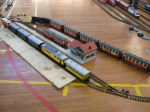 A number of G Gauge trains wait in the station