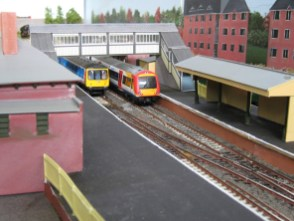 A pair of modern passenger trains in platforms 1 and 2.