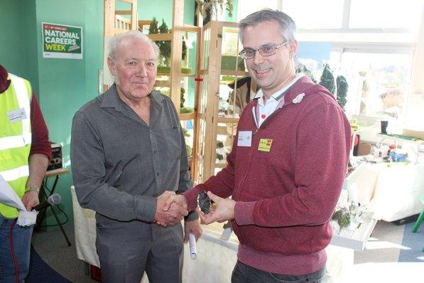 Bob Treacher presents the winners shield