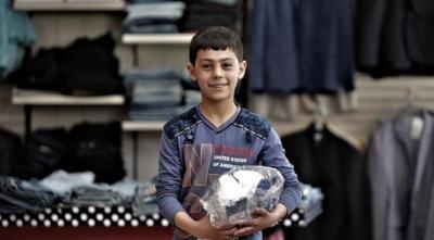 الهلال الأحمر التركي يهدي كسوة العيد لـ 100 ألف محتاج